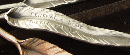 Sponsored copper and steel leaves stamped with names